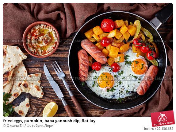 Купить «fried eggs, pumpkin, baba ganoush dip, flat lay», фото № 29136632, снято 31 августа 2018 г. (c) Oksana Zh / Фотобанк Лори