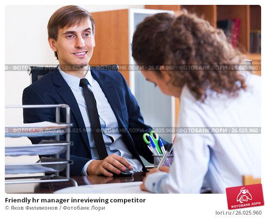 Купить «Friendly hr manager inreviewing competitor», фото № 26025960, снято 17 февраля 2020 г. (c) Яков Филимонов / Фотобанк Лори