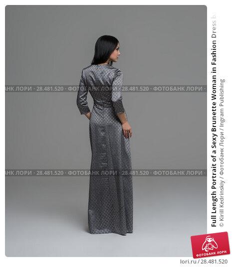 Купить «Full Length Portrait of a Sexy Brunette Woman in Fashion Dress back view», фото № 28481520, снято 30 октября 2014 г. (c) Ingram Publishing / Фотобанк Лори