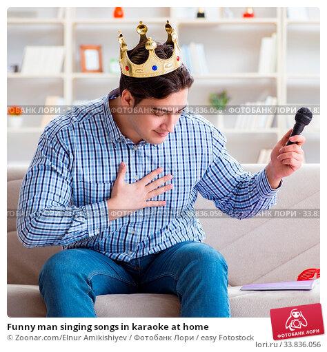 Купить «Funny man singing songs in karaoke at home», фото № 33836056, снято 26 мая 2020 г. (c) easy Fotostock / Фотобанк Лори