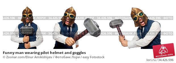 Funny man wearing pilot helmet and goggles. Стоковое фото, фотограф Zoonar.com/Elnur Amikishiyev / easy Fotostock / Фотобанк Лори