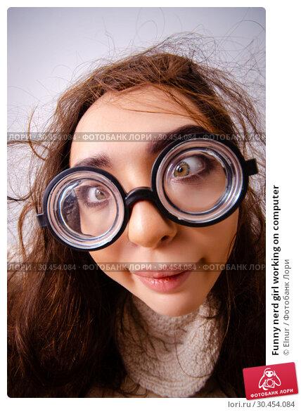 Funny nerd girl working on computer. Стоковое фото, фотограф Elnur / Фотобанк Лори