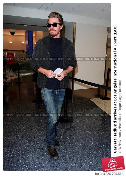 Купить «Garrett Hedlund arrives at Los Angeles International Airport (LAX) Featuring: Garrett Hedlund Where: Los Angeles, California, United States When: 28 Dec 2016 Credit: WENN.com», фото № 28700864, снято 28 декабря 2016 г. (c) age Fotostock / Фотобанк Лори