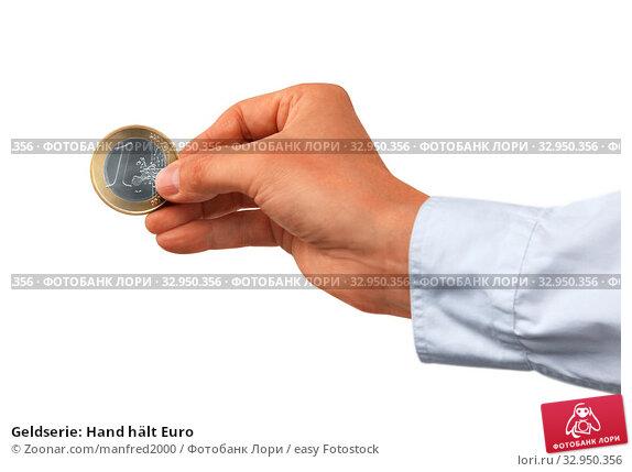 Geldserie: Hand hält Euro. Стоковое фото, фотограф Zoonar.com/manfred2000 / easy Fotostock / Фотобанк Лори