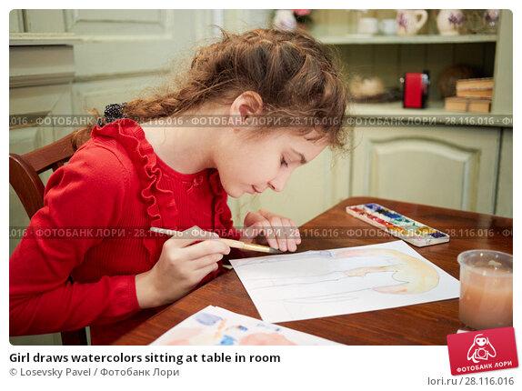 Купить «Girl draws watercolors sitting at table in room», фото № 28116016, снято 4 февраля 2017 г. (c) Losevsky Pavel / Фотобанк Лори