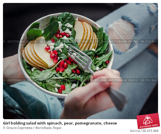 Купить «Girl holding salad with spinach, pear, pomegranate, cheese», фото № 30313364, снято 26 февраля 2019 г. (c) Ольга Сергеева / Фотобанк Лори