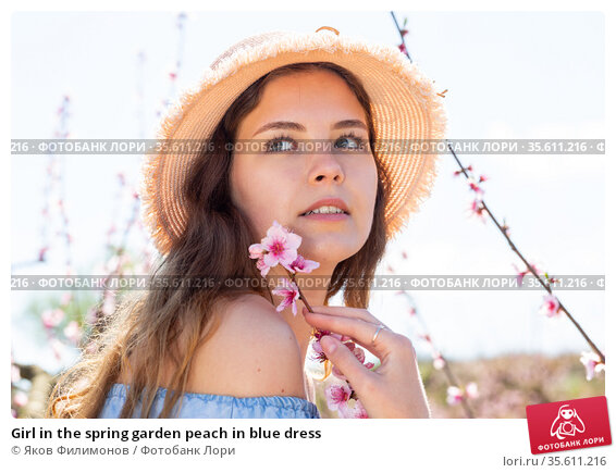 Girl in the spring garden peach in blue dress. Стоковое фото, фотограф Яков Филимонов / Фотобанк Лори