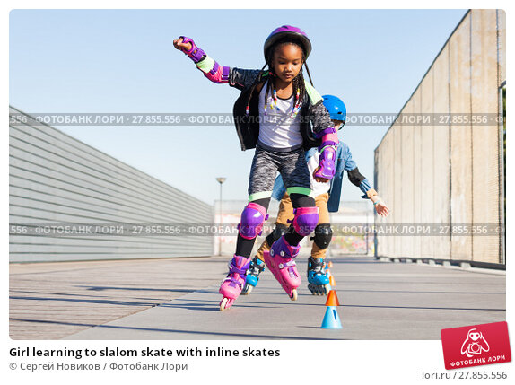 Купить «Girl learning to slalom skate with inline skates», фото № 27855556, снято 14 октября 2017 г. (c) Сергей Новиков / Фотобанк Лори