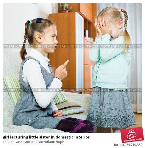 Купить «girl lecturing little sister in domestic interior», фото № 24710332, снято 8 декабря 2019 г. (c) Яков Филимонов / Фотобанк Лори