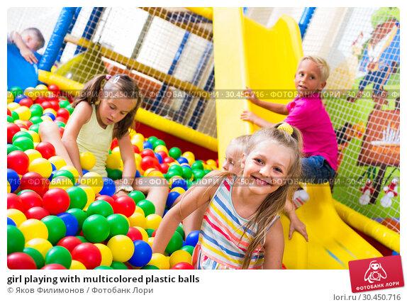 girl playing with multicolored plastic balls. Стоковое фото, фотограф Яков Филимонов / Фотобанк Лори