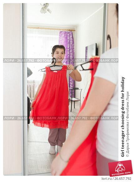 Girl teenager choosing dress for holiday; фото № 26657792 ...