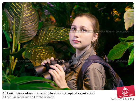 Купить «Girl with binoculars in the jungle among tropical vegetation», фото № 29542524, снято 7 декабря 2018 г. (c) Евгений Харитонов / Фотобанк Лори