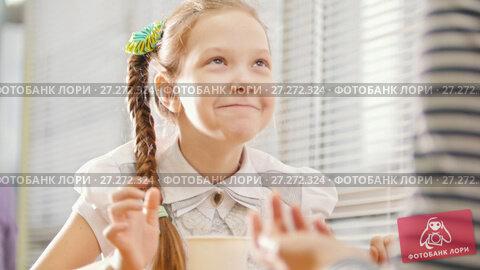 Купить «Girl with pigtail is eating sweets in the cafe, talking with her mum and dansing», видеоролик № 27272324, снято 15 декабря 2017 г. (c) Константин Шишкин / Фотобанк Лори