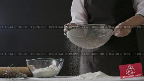 Купить «Girl's hands take white flour from glass bowl and sieve from sifter on a wooden table. Slow motion, Full HD video, 240fps, 1080p. Process preparing of homemade pastry.», видеоролик № 33886808, снято 2 июля 2020 г. (c) Ярослав Данильченко / Фотобанк Лори
