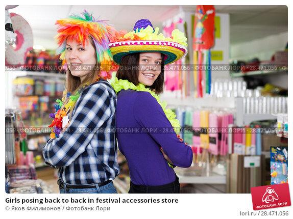 Купить «Girls posing back to back in festival accessories store», фото № 28471056, снято 15 марта 2018 г. (c) Яков Филимонов / Фотобанк Лори