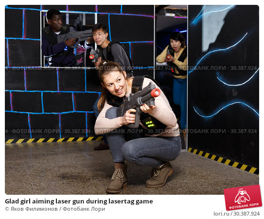 Купить «Glad girl aiming laser gun during lasertag game», фото № 30387924, снято 23 января 2019 г. (c) Яков Филимонов / Фотобанк Лори