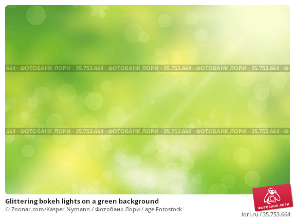Glittering bokeh lights on a green background. Стоковое фото, фотограф Zoonar.com/Kasper Nymann / age Fotostock / Фотобанк Лори