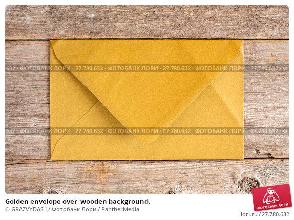 Купить «Golden envelope over  wooden background.», фото № 27780632, снято 17 февраля 2019 г. (c) PantherMedia / Фотобанк Лори
