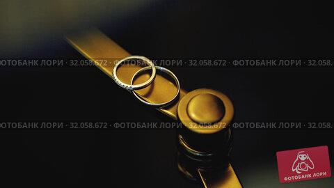 Golden Wedding Rings on In the contrast light of the lamp macro closeup shoot diamon Jewellery. Стоковое видео, видеограф Aleksejs Bergmanis / Фотобанк Лори