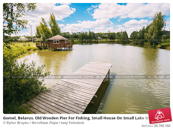 Купить «Gomel, Belarus. Old Wooden Pier For Fishing, Small House On Small Lake Or River.», фото № 28700160, снято 12 июня 2016 г. (c) easy Fotostock / Фотобанк Лори