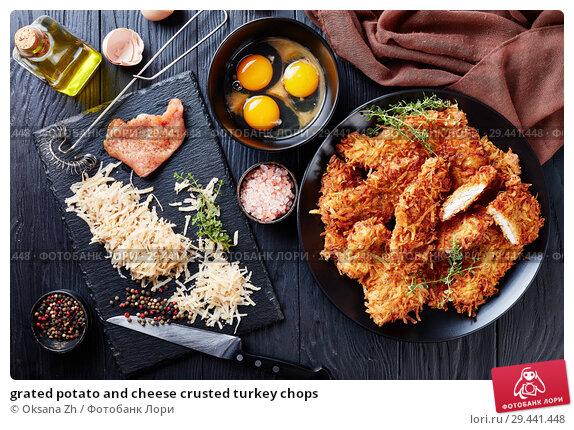 Купить «grated potato and cheese crusted turkey chops», фото № 29441448, снято 15 ноября 2018 г. (c) Oksana Zh / Фотобанк Лори