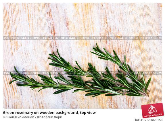 Купить «Green rosemary on wooden background, top view», фото № 33068156, снято 26 мая 2020 г. (c) Яков Филимонов / Фотобанк Лори