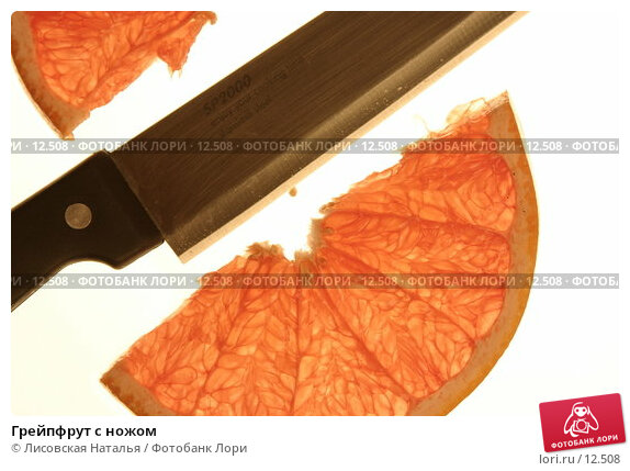 Грейпфрут с ножом, фото № 12508, снято 17 июля 2005 г. (c) Лисовская Наталья / Фотобанк Лори