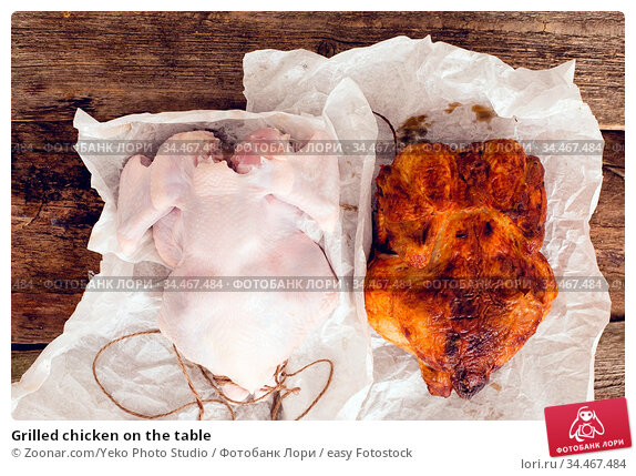 Grilled chicken on the table. Стоковое фото, фотограф Zoonar.com/Yeko Photo Studio / easy Fotostock / Фотобанк Лори