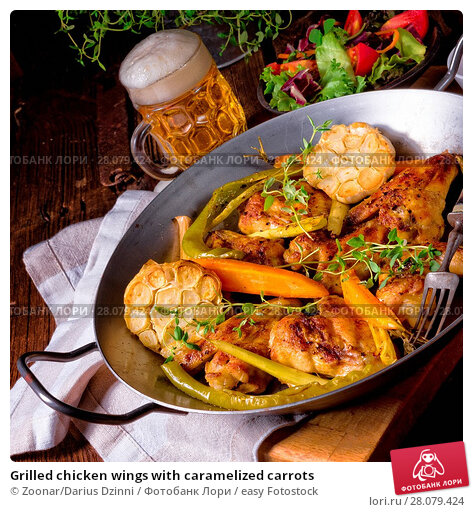 Купить «Grilled chicken wings with caramelized carrots», фото № 28079424, снято 20 января 2020 г. (c) easy Fotostock / Фотобанк Лори