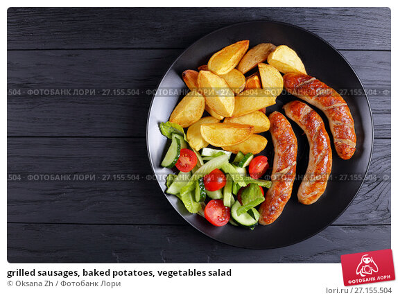 Купить «grilled sausages, baked potatoes, vegetables salad», фото № 27155504, снято 12 октября 2017 г. (c) Oksana Zh / Фотобанк Лори