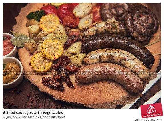 Купить «Grilled sausages with vegetables», фото № 27387712, снято 10 ноября 2017 г. (c) Jan Jack Russo Media / Фотобанк Лори