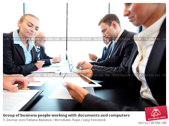 Group of business people working with documents and computers. Стоковое фото, фотограф Zoonar.com/Tatiana Badaeva / easy Fotostock / Фотобанк Лори