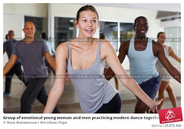 Купить «Group of emotional young woman and men practicing modern dance together», фото № 29875440, снято 30 июля 2018 г. (c) Яков Филимонов / Фотобанк Лори