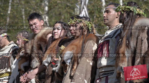 Group of indigenous people of Kamchatka in traditional clothing during Itelmens national ritual festival thanksgiving nature Alhalalalay. Kamchatka Peninsula (2019 год). Редакционное видео, видеограф А. А. Пирагис / Фотобанк Лори