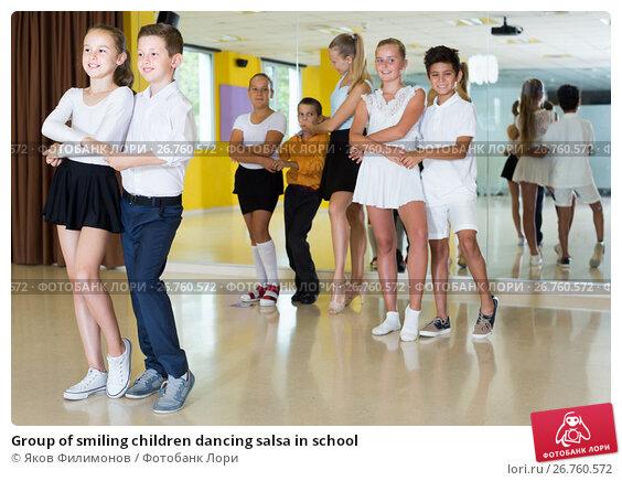 Купить «Group of smiling children dancing salsa in school», фото № 26760572, снято 13 июля 2017 г. (c) Яков Филимонов / Фотобанк Лори