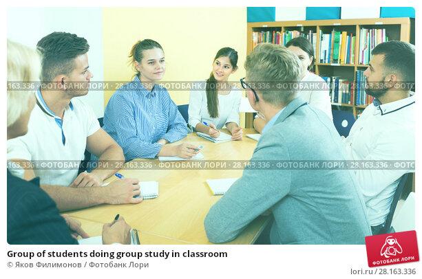 Купить «Group of students doing group study in classroom», фото № 28163336, снято 5 октября 2017 г. (c) Яков Филимонов / Фотобанк Лори
