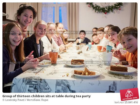 Купить «Group of thirteen children sits at table during tea party», фото № 25841416, снято 16 января 2015 г. (c) Losevsky Pavel / Фотобанк Лори