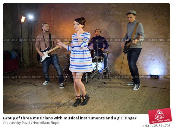 Купить «Group of three musicians with musical instruments and a girl singer», фото № 25841708, снято 9 декабря 2014 г. (c) Losevsky Pavel / Фотобанк Лори