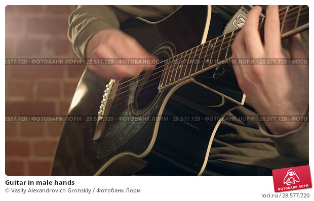 Купить «Guitar in male hands», фото № 28577720, снято 21 июня 2018 г. (c) Vasily Alexandrovich Gronskiy / Фотобанк Лори