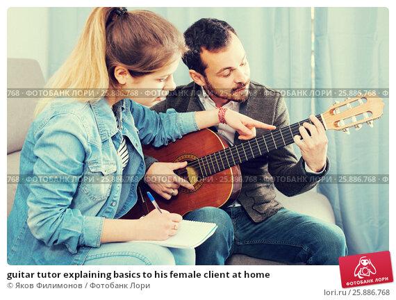 Купить «guitar tutor explaining basics to his female client at home», фото № 25886768, снято 4 марта 2017 г. (c) Яков Филимонов / Фотобанк Лори