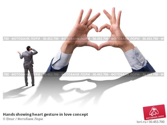 Hands showing heart gesture in love concept. Стоковое фото, фотограф Elnur / Фотобанк Лори