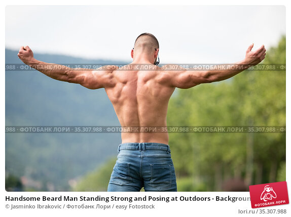 Handsome Beard Man Standing Strong and Posing at Outdoors - Background... Стоковое фото, фотограф Jasminko Ibrakovic / easy Fotostock / Фотобанк Лори