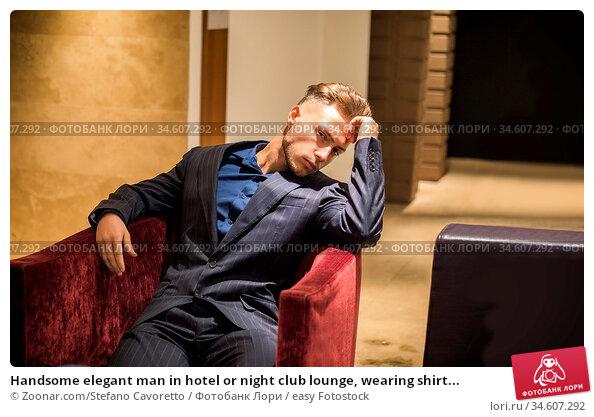 Handsome elegant man in hotel or night club lounge, wearing shirt... Стоковое фото, фотограф Zoonar.com/Stefano Cavoretto / easy Fotostock / Фотобанк Лори