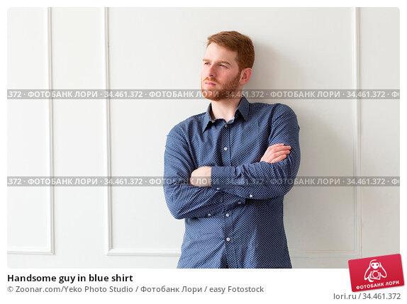 Handsome guy in blue shirt. Стоковое фото, фотограф Zoonar.com/Yeko Photo Studio / easy Fotostock / Фотобанк Лори