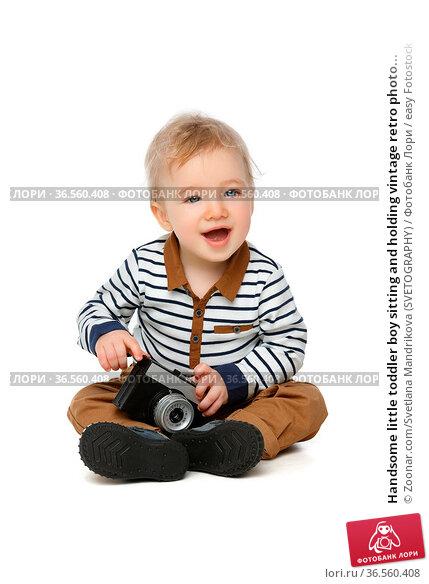 Handsome little toddler boy sitting and holding vintage retro photo... Стоковое фото, фотограф Zoonar.com/Svetlana Mandrikova (SVETOGRAPHY) / easy Fotostock / Фотобанк Лори