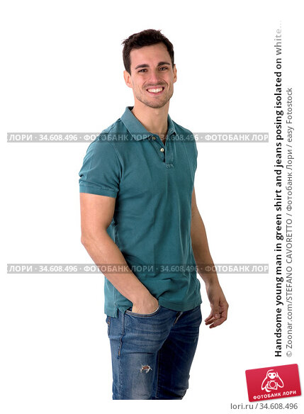 Handsome young man in green shirt and jeans posing isolated on white... Стоковое фото, фотограф Zoonar.com/STEFANO CAVORETTO / easy Fotostock / Фотобанк Лори