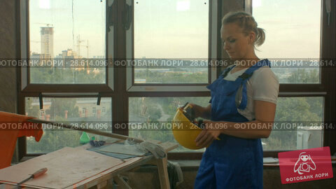 Купить «Happy attractive constructor getting ready for work and get dress», видеоролик № 28614096, снято 4 июня 2018 г. (c) Vasily Alexandrovich Gronskiy / Фотобанк Лори