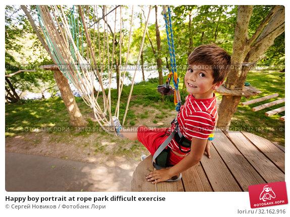 Купить «Happy boy portrait at rope park difficult exercise», фото № 32162916, снято 2 июня 2019 г. (c) Сергей Новиков / Фотобанк Лори