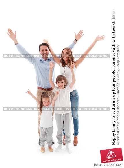 Happy family raised arms up four people, parents with with two children... Стоковое фото, фотограф Zoonar.com/Tatiana Badaeva / easy Fotostock / Фотобанк Лори