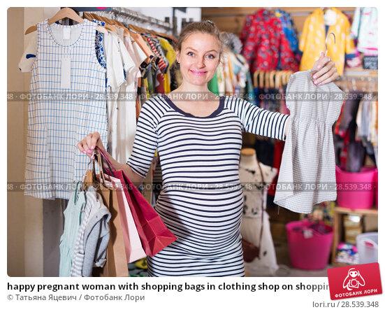 Купить «happy pregnant woman with shopping bags in clothing shop on shopping», фото № 28539348, снято 6 апреля 2017 г. (c) Татьяна Яцевич / Фотобанк Лори